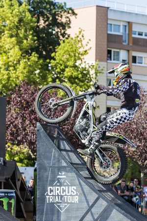 LE TRAIT, SEINE MARITIME, NORMANDY, FRANCE - SEPTEMBER 01, 2018. Moto-show in central square of city. Tricks on ATV stuntmen, Stunt Riding - Wheelie, Stoppie and extreme acrobatics somersault on motorbike with platform. Outdoor spectacle Reklamní fotografie - 120227556