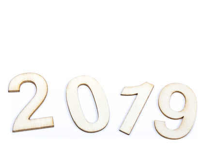 Close up 2019 year celebrate with wooden numbers on white background. Clean, cleaned, purity design. Copy space