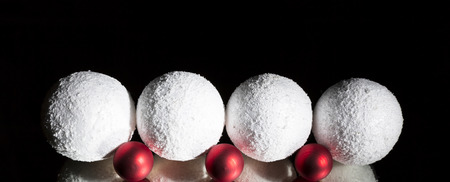 White red christmas decorative ball ornaments on a mirror in front of a black background. Low key photography. Luxury creative design purity concept. To write 2019 on. Banner size Stock fotó