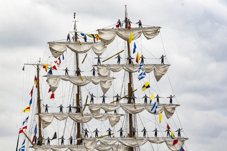ROUEN, FRANCE - JULY Circa, 2016. End of the Armada in Rouen, boats galleon ships on the river Seine. Differents naval transportation going to their country. Men woman standing up on the matts boat sail. Very important International festival in France, ne