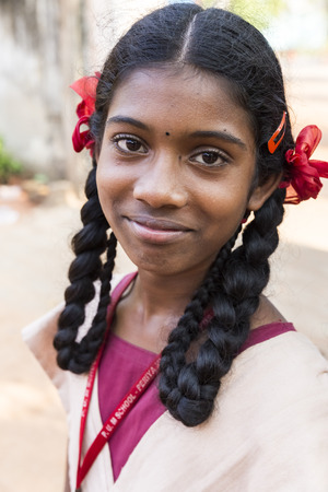 PUDUCHERY, INDIA - MARCH Circa, 2018 : Unidentified girl teenager portrait at school facing the camera in playground outdoor. Smiling, happy, excited, shy, timid, proud face. Emotions and feelings. Editorial
