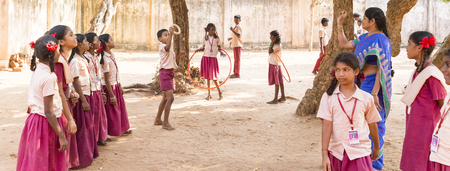 PUDUCHERY, INDIA - MARCH Circa, 2018 : Unidentified teacher playing game with boys and girls smiling, happy, excited, funny, outoor, playground. Multiracial and charity ngo concept. Panoramic banner Editorial