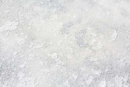 Close up of sea salt in salt farm, India