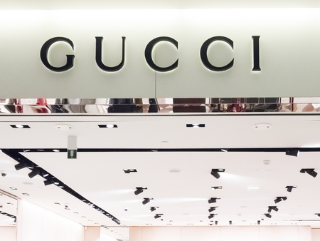 PARIS, FRANCE - NOVEMBER Circa, 2018. Gucci store front in the mall in airport Charles de Gaulle at Paris. Gucci is an Italian luxury brand of fashion and leather goods.