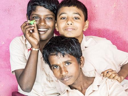 PUDUCHERRY, INDIA - DECEMBER Circa, 2018. Unidentified best children boys friends classmates in government school uniforms smiling standing with hand on shoulder. Portrait of multiethnic schoolchilds enjoying friendship. Archivio Fotografico - 120377185