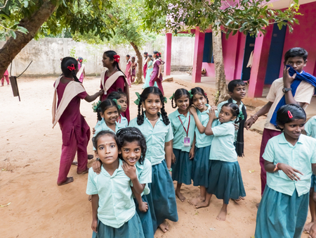 PUDUCHERRY, INDIA - DECEMBER Circa, 2018. Unidentified group best children girls friends classmates in government school uniforms smiling standing with hand on shoulder. Portrait of multiethnic schoolchilds enjoying friendship. Stock Photo - 120377192