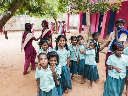PUDUCHERRY, INDIA - DECEMBER Circa, 2018. Unidentified group best children girls friends classmates in government school uniforms smiling standing with hand on shoulder. Portrait of multiethnic schoolchilds enjoying friendship.