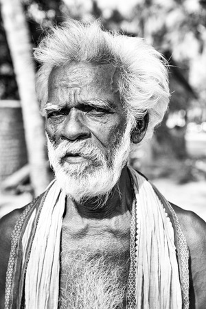 PUDUCHERRY, INDIA - DECEMBER Circa, 2018. Unidentified portrait close-up of old face indian man looking at the camera,very serious. Black and white image Editorial