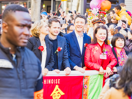 PARIS, FRANCE - FEBRUARY 17, 2019. Last day of the chinese new year celebration festival.Politician official people VIP in the street during the parade festival. Traditional celebration and customs.