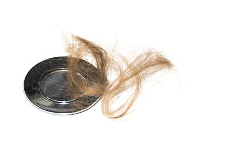 Hair loss on washbasin. Long brown hair on white basin in the bathroom. Healthcare concept