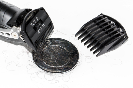 Electrical black shaver with accessories over white background in the wash basin. Close-up. Beauty care concept