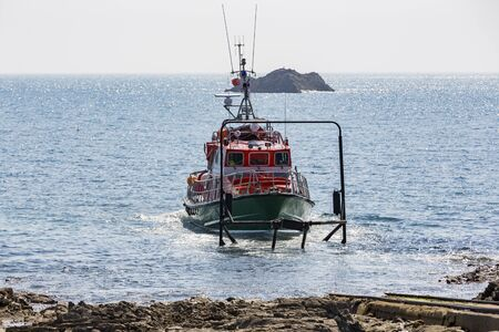Documentary editorial image. GOURY, HAGUE HEADLAND, FRANCE, EUROPE - May circa, 2018. Life boat on the sea, ready to go for rescue operation at Raz Blanchard, the strongest tidal currents in the world.