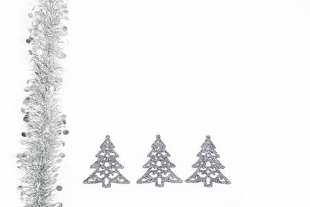 Christmas silver grey garland and silver trees decoration photo on white background.