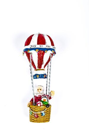 Santa Claus in Hot air balloon flight on white background. Place to write
