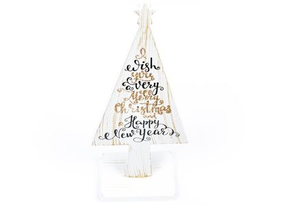 Beautiful Minimal Christmas wood white tree with Merry Christmass and happy new year written, on white backgound