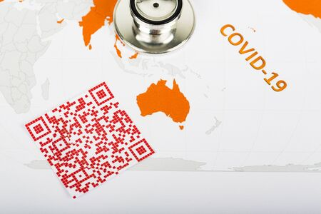World map with red colorful illegible QR Code for coronavirus Covid-19 infection used in company for workers to know about their health virus infection.