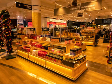 Paris, France - September 18, 2020. Maxim's products on sale in duty free shop at Paris airport, France. Famous brand of food, french landmark