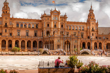SEVILLA, SPAIN - JUNE Circa, 2020. Panorama of the Spain Square Plaza de Espana in Seville, with bridges over the canal, lake, fountain, towers and main entrance to the building. Example of Moorish and Renaissance revival. Redakční