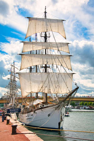 ROUEN, FRANCE - JUNE Circa, 2019. Marite, French three-masted schooner on the Seine river for Armada exhibition in France. Also used for transat Jacques Vabre. Against cloudy sky