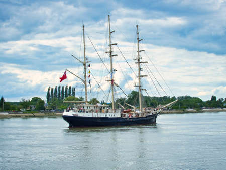 ROUEN, FRANCE - JUNE Circa, 2019. The British tall ship Tenacious, three-masted schooner, on the Seine river for Armada parade. The largest wooden sailing yachts in the world. For disabled people to sail. Editorial