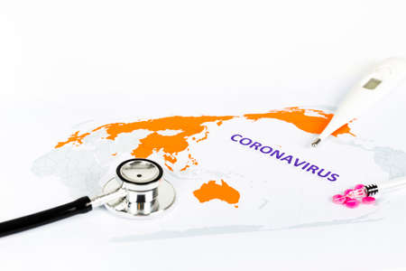 Text phrase Coronavirus on world map with orange countries infected by virus, on white background. Copy space. With stetoscope, pills, syringe, thermometer