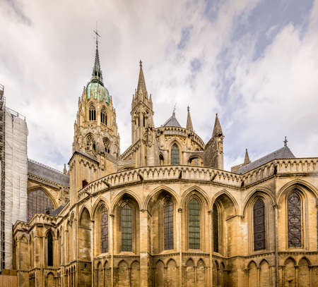 BAYEUX, FRANCE - SEPTEMBER Circa, 2020. Exterior of Cathedral Notre Dame, gothic church built in 1862. Famous place for tourists to visit