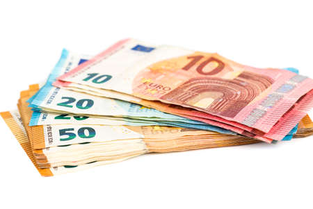 various denominations of euro banknotes on white. Place for text. Economic crisis concept