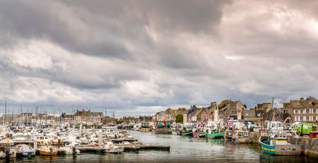 SAINT VAAST, FRANCE - SEPTEMBER Circa, 2020. Dramatic cloudy Sky landscape on the harbor with sailboats. Panorama, dark pessimist atmosphere feelings Editorial