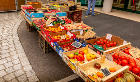 SAINT VAAST LA HOUGE, FRANCE - SEPTEMBER Circa, 2020. After end of lockdown, On street vegetables market no customer no business during social distancing and global quarantine from epidemic of COVID-19 virus. Impact of COVID-19 at small business Editorial