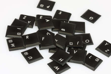 Scattered keyboard letters on white background