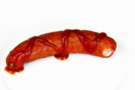 Ham bratwurst with ketchup on white background Stock Photo - 8957388