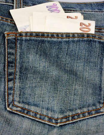 Czech money in pocket of jeans
