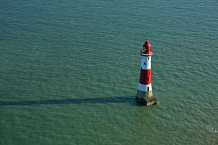 Lighthouse in sea Stock Photo