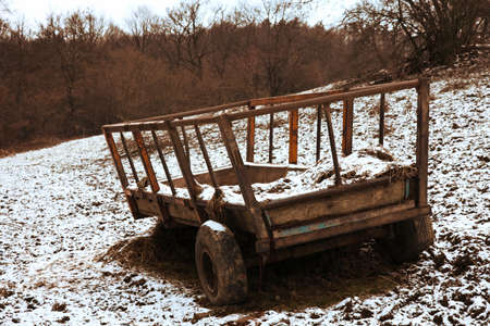 Hay cart in winter, covered with snow Stock Photo