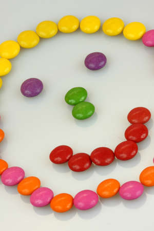Happy face made of colorful candies