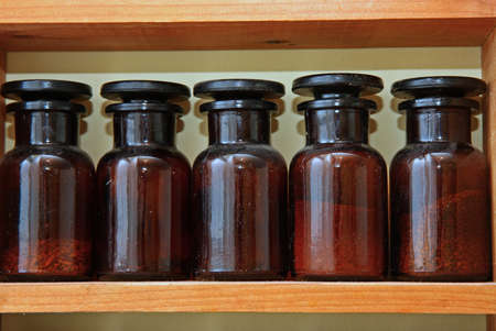 Laboratory bottles in shelve Stock Photo