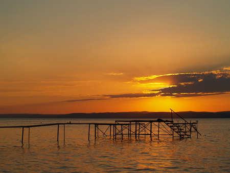 Pier in Balaton in sunset Stock Photo