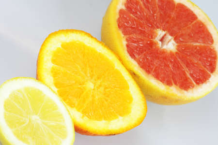 Lemon, orange and grapefruit on white background