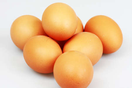 Pile of eggs on white background