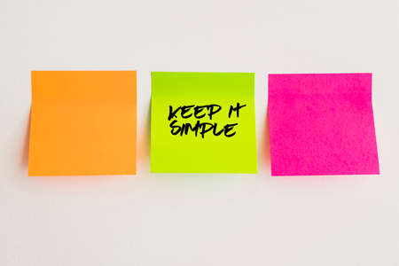Keep it simple, sticky note, orange, pinky and green adhesive note quote concept