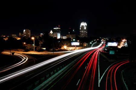 north carolina: view of interstate 40 and downtown winston salem, north carolina, skyline at night, light trails to portray motion