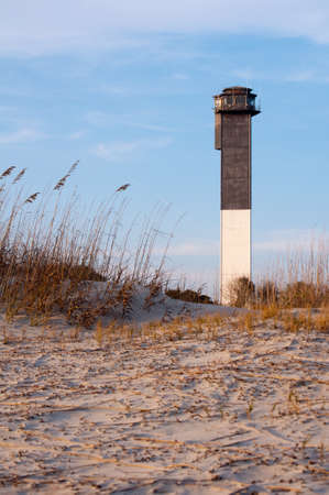 sc: Among the last lighthouses to be built along the Atlantic Coast is the 140-foot Sullivans Island Lighthouse, which is located at the entrance of the Charleston Harbor  It was built in 1960 and first lit on June 15, 1962 - taken from the beach during at su