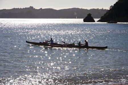 outrigger: Sunrise, outrigger canoe at Paihia, Bay of Islands New Zealand Stock Photo