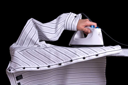 It appears as if a shirt is ironing itself. Stock Photo