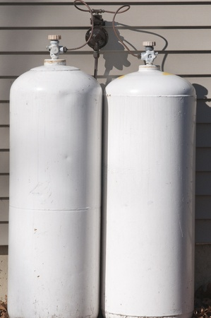 hooked up: A pair of propane tanks hooked up to a house