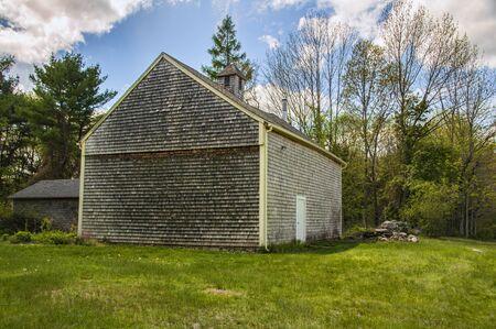 A barn in a small field