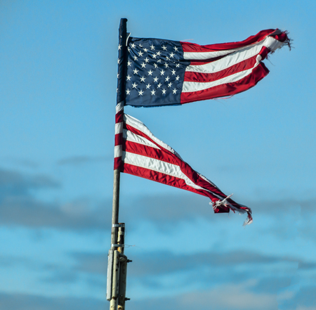 A torn flag blowing in the wind