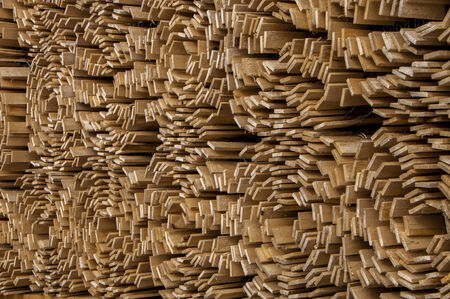 Wooden slat fencing rolls stacked up
