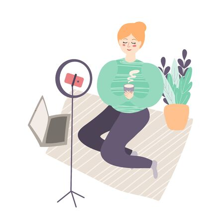illustration of a young Slavic girl blogger with red hair in a sweater resting over a cup of coffee on a carpet with a laptop.girl takes herself on camera phone for a blog at home.home vlog.flat style Ilustracja