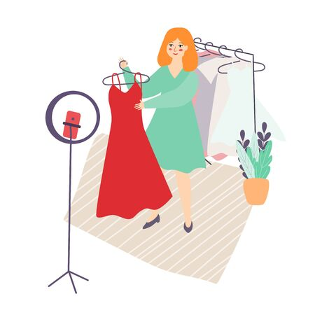 Illustration of a young Slavic blogger girl with red hair shows dresses clothes on video, photo. A girl stylist shoots on the camera phone for a blog. home vlog.flat style, vector Ilustração